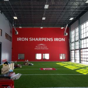 D1 Sports Holdings Iron Sharpens Iron